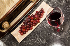 Vintage Radio and red Wine. A glass of red wine with music from the radio Stock Photography