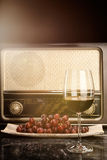 Vintage Radio and red Wine. Vintage Radio, grapes and a glass of red wine Royalty Free Stock Photo