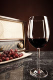 Vintage Radio and red Wine. Vintage Radio, grapes and a glass of red wine Royalty Free Stock Image