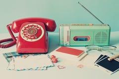 Vintage radio and telephone. Vintage radio, telephone and letters Royalty Free Stock Image