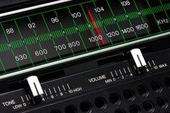 Vintage radio tuner. Black vintage radio tuner closeup with tone and volume control Stock Image