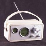 Vintage radio. White vintage radio over black tissue background Royalty Free Stock Photography