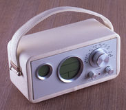 Vintage radio. A vintage white radio over wooden table Stock Images