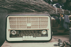 Vintage Radio. On wood table with various utensils Stock Image