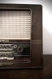 Vintage radio on wooden dresser. Wooden vintage radio in detail on wooden dresser Royalty Free Stock Images