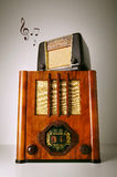 Vintage Radios. Two old retro revival radios on top of another with music notes Stock Photos