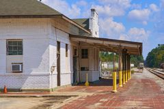 Old vintage railroad depot. Vintage railroad depot located in small town next to railroad tracks Royalty Free Stock Photo