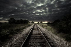 Vintage railroad track. Vintage railroad at cloudy night. Art design Royalty Free Stock Photography