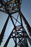 Vintage railway bridge repurposed as a walkway across the Ohio r. Iver. Rising steel beams create shaddows on the walkway royalty free stock photo