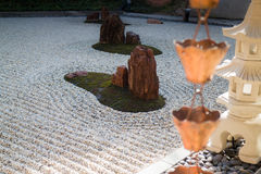 Vintage rain waters way-out in zen garden Royalty Free Stock Images