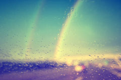 Vintage rainy windshield with rainbows Royalty Free Stock Image