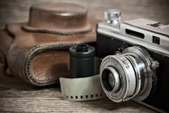 Vintage rangefinder camera with leather case. Vintage rangefinder camera with film and leather case Stock Photo