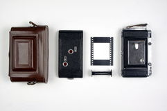 Vintage Rangefinder Film Camera Components Organized on a White Background Stock Images