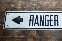 Vintage Ranger Station Sign on Old Barn Wood Floor Royalty Free Stock Photos