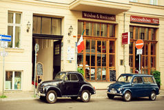 Vintage rare automobiles parked past historical buildings street of Berlin Royalty Free Stock Photography