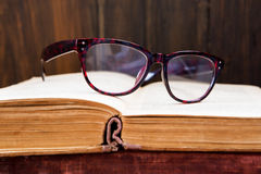 Vintage reading glasses on the book Stock Image