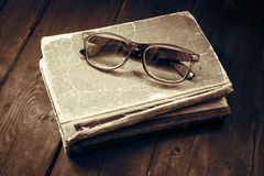 Vintage reading glasses on the books stack Royalty Free Stock Images