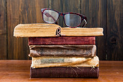 Vintage reading glasses on the books Royalty Free Stock Photos