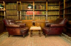 Vintage reading room. Old studying room with two leather armchairs and chess game