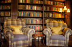 Vintage reading room. Old studying room with two leather armchairs and chess game Stock Images