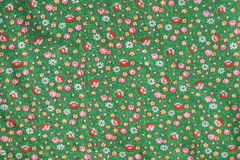 Vintage real fabric 1960s cotton emerald green with red roses and yellow flower pattern Stock Image