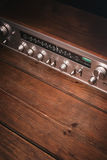 Vintage receiver on a wooden background. Stock Photo