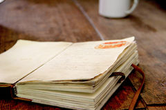 Vintage Recipe Book. A vintage recipe book on dining table Royalty Free Stock Photography