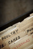 Vintage Recipe Box. Old recipe box, with focus on section for cakes Royalty Free Stock Photo