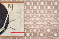 Free Vintage Record Player In Front Of Retro Brown Wallpaper With Copy Space Stock Photos - 215846033