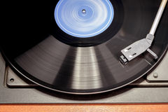 Vintage record player with spinning vinyl. Stock Photos