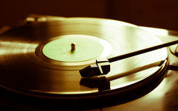 Vintage record player with vinyl disc, close-up.  Stock Photo