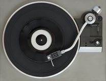 Vintage record player with vinyl record royalty free stock photography