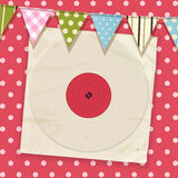 Vintage record and sleeve with bunting on a pink polka dot backg Stock Photography
