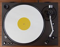 Vintage Record Turntable Player With White Vinyl Disk. Vintage Record Turntable Player Tonearm With White Vinyl Disk Top View Yellow label Stock Photography