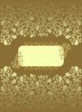 Vintage rectangular frame with  ocher color decor. And floral designs on a brown background Stock Photography