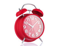 Vintage red alarm clock isolated on white background Royalty Free Stock Image