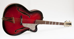 Vintage red archtop guitar Stock Photos