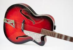 Vintage red archtop guitar Royalty Free Stock Photos