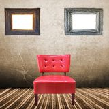 Vintage red armchair with interior room Stock Image
