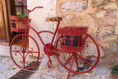 Vintage red bike. Vintage red decorative bicycle in old town stock images