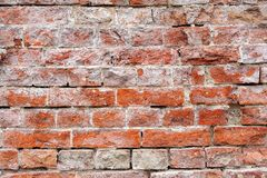 Vintage red brick wall texture background. Vintage red brick wall with sprinkled white plaster texture background Royalty Free Stock Photo