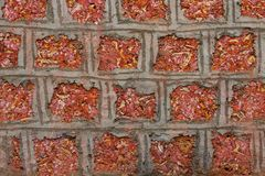 Vintage Red Brick Wall With Rough Surface And Dark Stain Taken From An Old Town In India. The Pattern And Brickwork Texture Give I