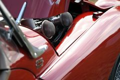 Vintage red British race car. Detail with engine and air cleaners Royalty Free Stock Images