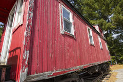 Vintage red caboose parked on rails, North Conway, New Hampshire Royalty Free Stock Images