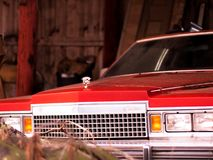 Vintage Cadillac sitting in a barn undisturbed Royalty Free Stock Image
