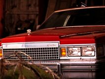 Vintage Cadillac sitting in a barn undisturbed Royalty Free Stock Photo