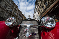 Vintage red car in front of Prague castle Royalty Free Stock Image