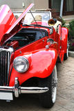 Vintage red car. Vintage car with open engine hood Stock Image
