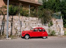 Vintage red car on the street in the south of Europe near the sea stock photography