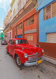 Vintage red car on the street of old city, Cuba Stock Photography